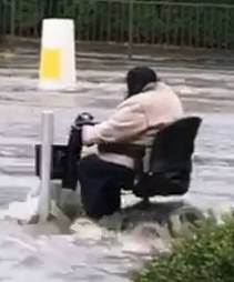 The woman was not daunted by the floods in Sheffield