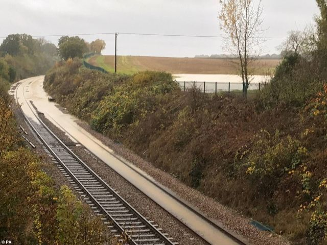 A photo issued by Network Rail of flooded track at Kiveton in South Yorkshire as rail commuters face chaos this morning