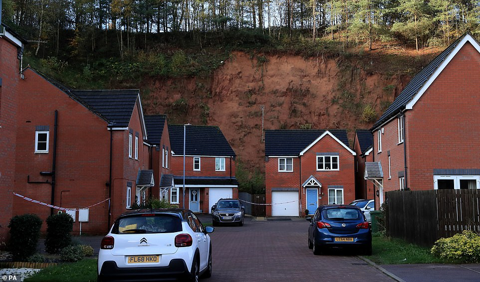 The mudslide, pictured today, which has forced the evacuation of residents of Bank End Close in Mansfield, Nottinghamshire