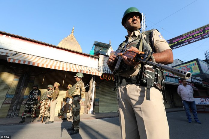 Muslim organizations have called for calm to prevent community explosions. Pictured: Indian paramilitary soldiers stand guard in the old city of Jammu, India