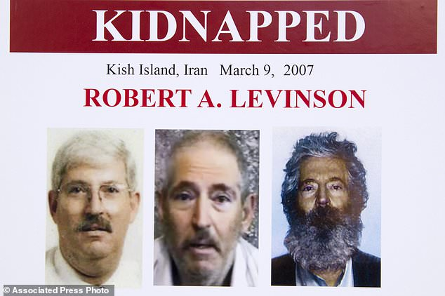 An FBI poster showing a composite image of former FBI agent Robert Levinson, (right), of how he would look like now after five years in captivity, and an image, (center), taken from the video, released by his kidnappers, and a picture before he was kidnapped, (left)