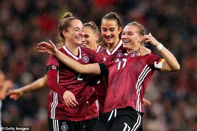 Alexandra Popp of Germany celebrates scoring the opening goal during Saturday's friendly