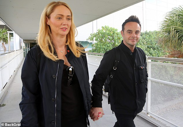 Smiley: Ant grinned as he crossed the airport with Anne-Marie at his side. He was clearly pleased to be back after being replaced by Holly Willoughby last year
