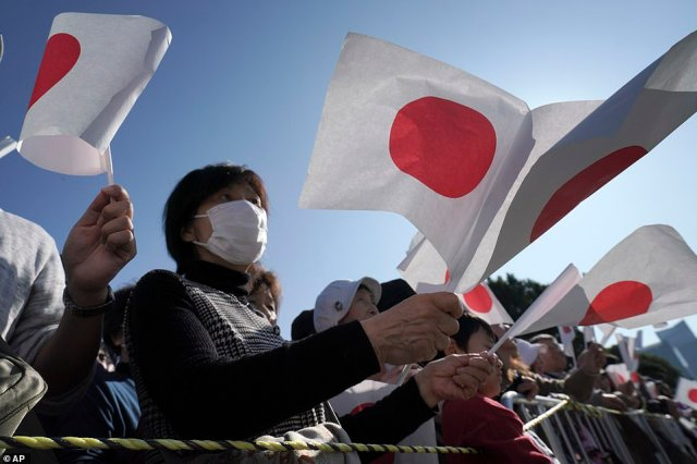 Takahiro Suzuki, 75, retiree who traveled from Chigasaki, west of Tokyo, arrived two hours ahead of the parade and said it was worth it (file image)