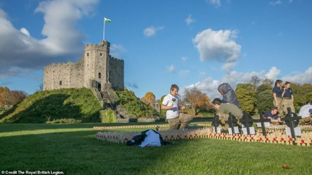 In Cardiff, volunteers constructed a 'field of remembrance' containing120,000 miniature crosses bearing tributes to loved ones who had died in conflicts