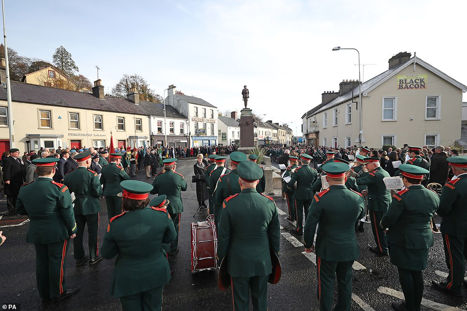 Crowds gather around a marching band at the Remembrance Sunday service at the Cenotaph in Enniskillen, held in tribute for members of the armed forces who have died in major conflicts