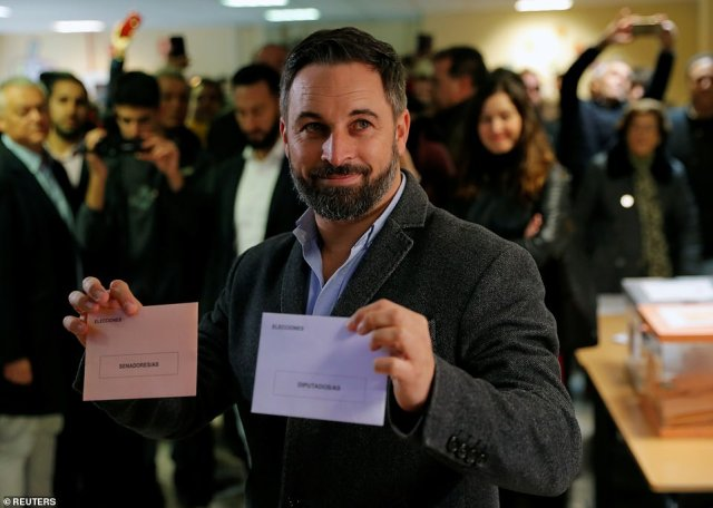 And far-right leader of Vox Santiago Abascal pictured casting his vote in the country's capital. The party, which favours 'drastic solutions' to the Catalonian independence question has seen a surge in the polls
