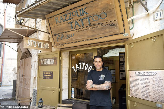 Wassim Razzouk outside his shop. The Razzouk family have been tattooing Christian pilgrims since the year 1300