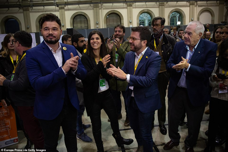Polls in the Canary Islands remain open for another hour. Local authorities of small town in northeastern Spain say that police have arrested a man who was carrying a pistol in a polling station in Sunday's national election. Pictured:The number two of ERC to the Parliament by Barcelona, Gabriel Rufian (first from left), and Pere Aragones