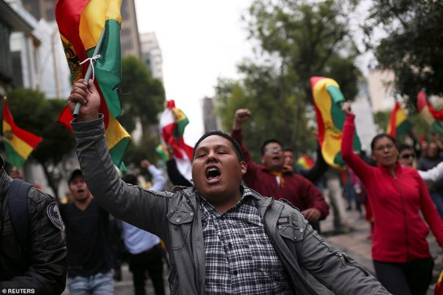 People protest against Bolivia's now former President Evo Morales in La Paz, on Sunday
