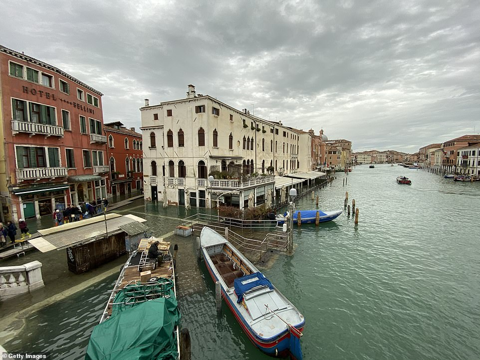 Canal boats are seen in the high water in Venice today. The floods on Tuesday left some gondolas and ferries stranded