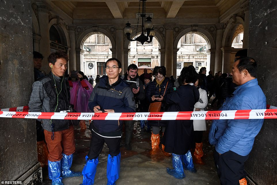 Disappointment: Tourists hoping to see St Mark's Square were kept behind a police cordon this morning because of the flood