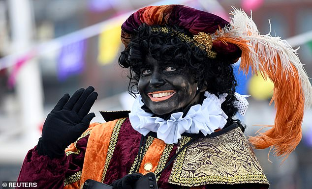 Parades held in early December have seen people dress up with curly wigs, bright lipstick and the black face paint to depict the character who is said to be black because he is a Moor from Spain (pictured is a parade last year)