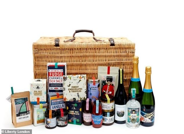Liberty London's Looden hamper, which comes in a big reusable hamper, with leather buckles and a carry handle is great value for money, with three bottles of wine and also a bottle of gin