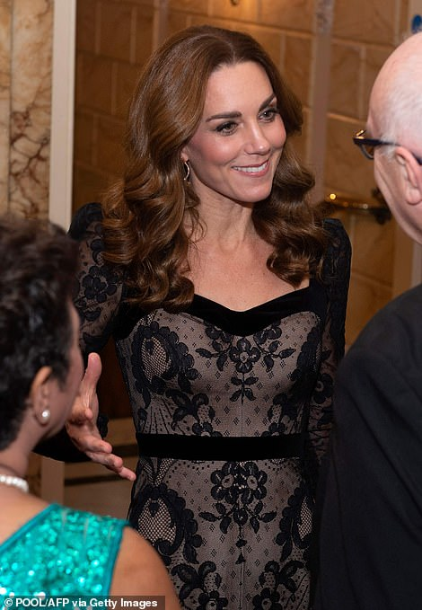 Duchess of Cambridge, gestured as she animatedly spoke to guests as she arrived to attend the Royal Variety Performance