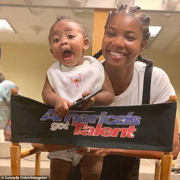 Racist? Union received more than half a dozen notes criticizing hairstyles as 'too black' for the show's core audience (pictured with year-old daughter Kaavia James on August 13)