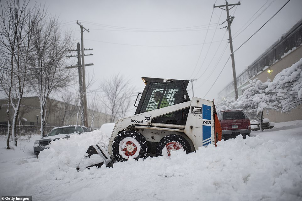 A man plows snow after a blizzard struck overnight on Tuesday in Minneapolis, Minnesota. Two major winter storms thrashing the western two-thirds of the United States on Wednesday appear set to disrupt the travel plans of millions of Americans headed to Thanksgiving Day destinations on jam-packed highways and airplanes