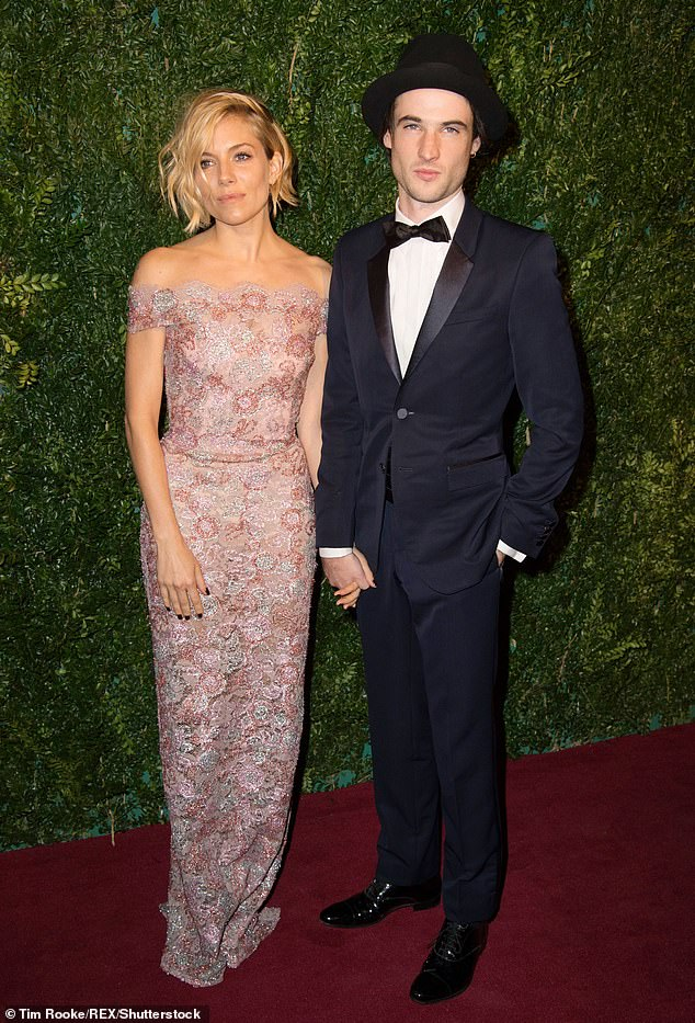 Co-parenting: Tom has a daughter, Marlowe, eight, whom he shares with ex-fiancée Sienna Miller. She is said to be engaged to her new beau, Lucas Zwirner, 29 (pictured 2014)
