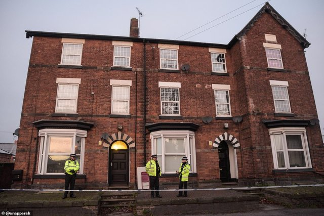 Staffordshire police officers stand guard at a property in Stafford where it is believed London Terrorist, Usman Khan, lived before his attack