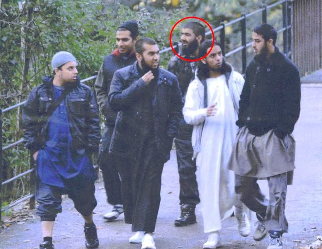 Khan, circled third from the right, had been arrested along with his Al Qaeda cell, pictured, after they were planning a pre-Christmas terror campaign in 2010. Officers had tracked the group, who included from left, Mohibur Raham, Gurukanth Desai, Abdul Miah, Usman Khan, Mohammed Chowdhury and Mohammed Shahjahan in Roath Park in November 2010