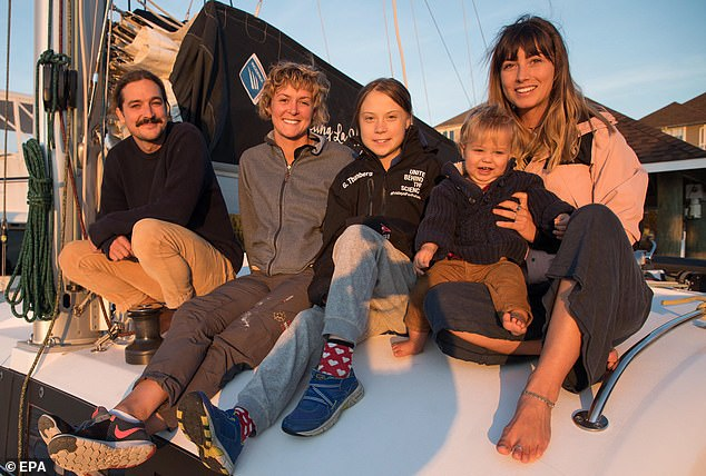 Nikki Henderson's (second left) flight to the US to help Greta Thunberg (centre) sail to Portugal has produced the same amount of carbon emissions the voyage hoped to save. Miss Thunberg can be seen with Australian couple Riley Whitelum (left) and Elayna Carausu (right), and Ms Henderson (second left) on board La Vagabonde