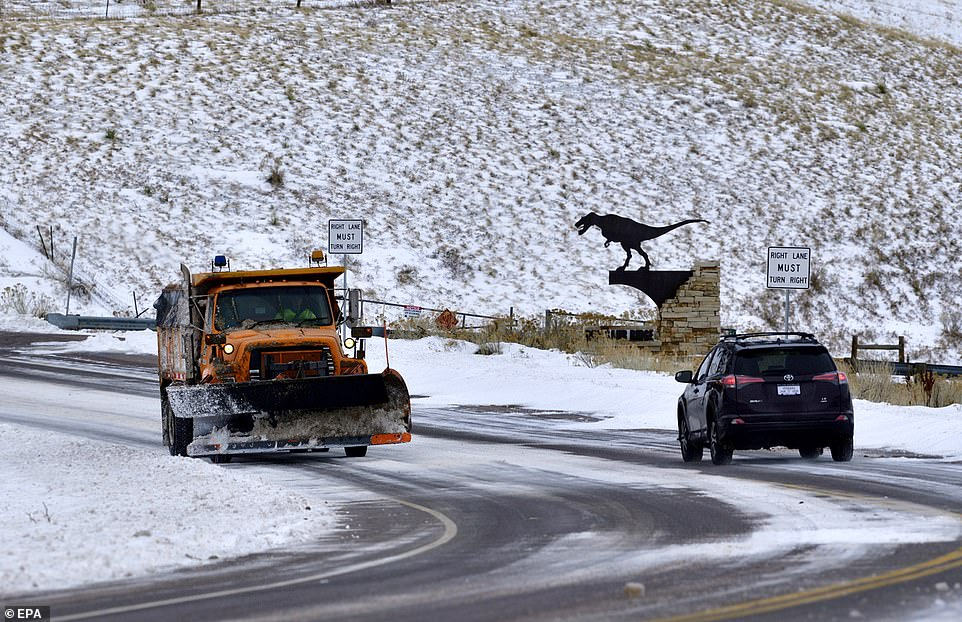 Snow plow works at snow removal off Interstate Highway 70 in the foothills west of Denver, Colorado on Saturday
