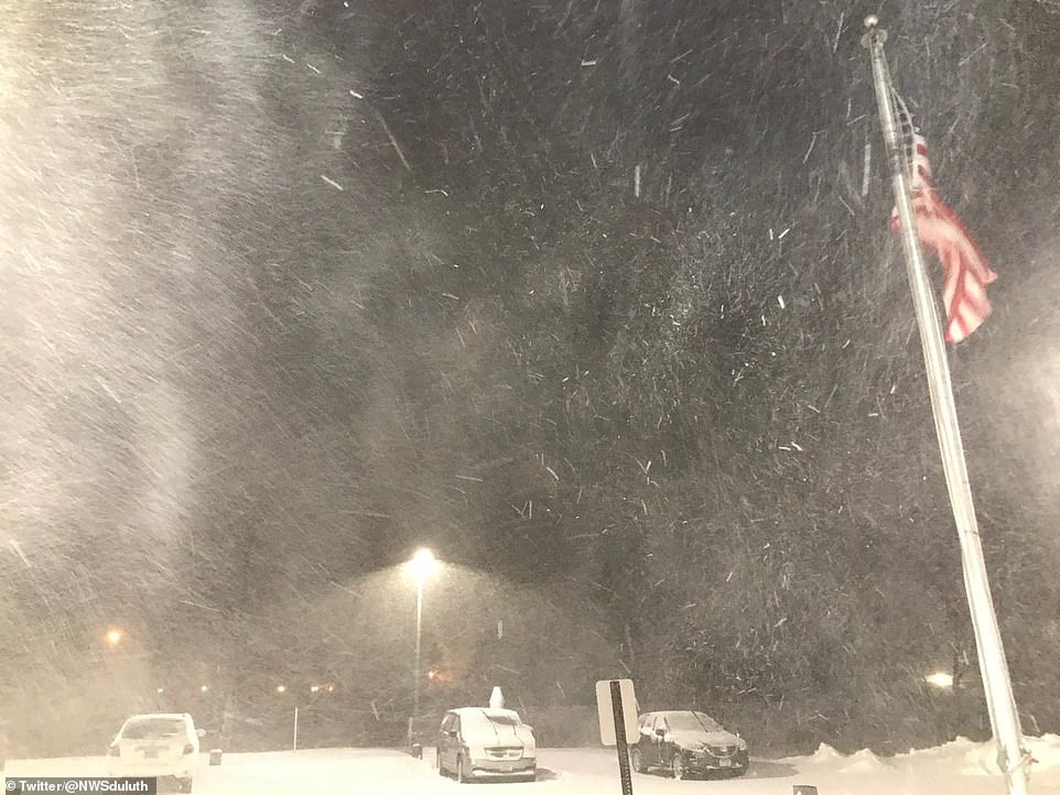 Blizzard conditions were reported at Lake Superior in Minnesota as an inch of snow fell per hour on Saturday evening