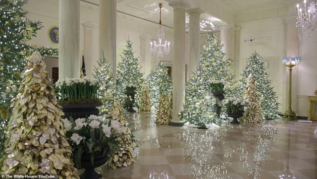 Stunning images from inside the White House show this year's festive display. Melania wrote of the decorations: 'I am delighted to share this beautiful exhibit of patriotism for all to see, and excited for everyone to experience the beauty of the #Christmas season!'