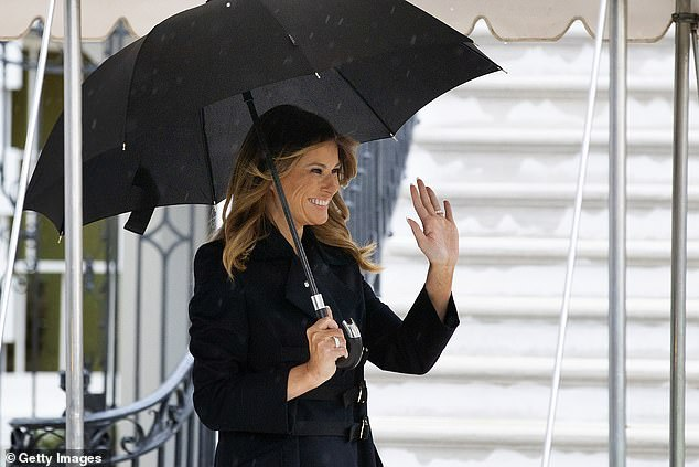 Mrs Trump smiles and waves as she leaves the White House today before boarding Marine One. She is traveling with her husband to London