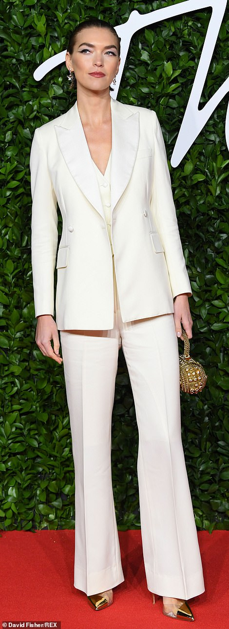 Suit you: Model Arizona, 31, opted for a classic white three-piece tuxedo by sustainable fashion brand Deck