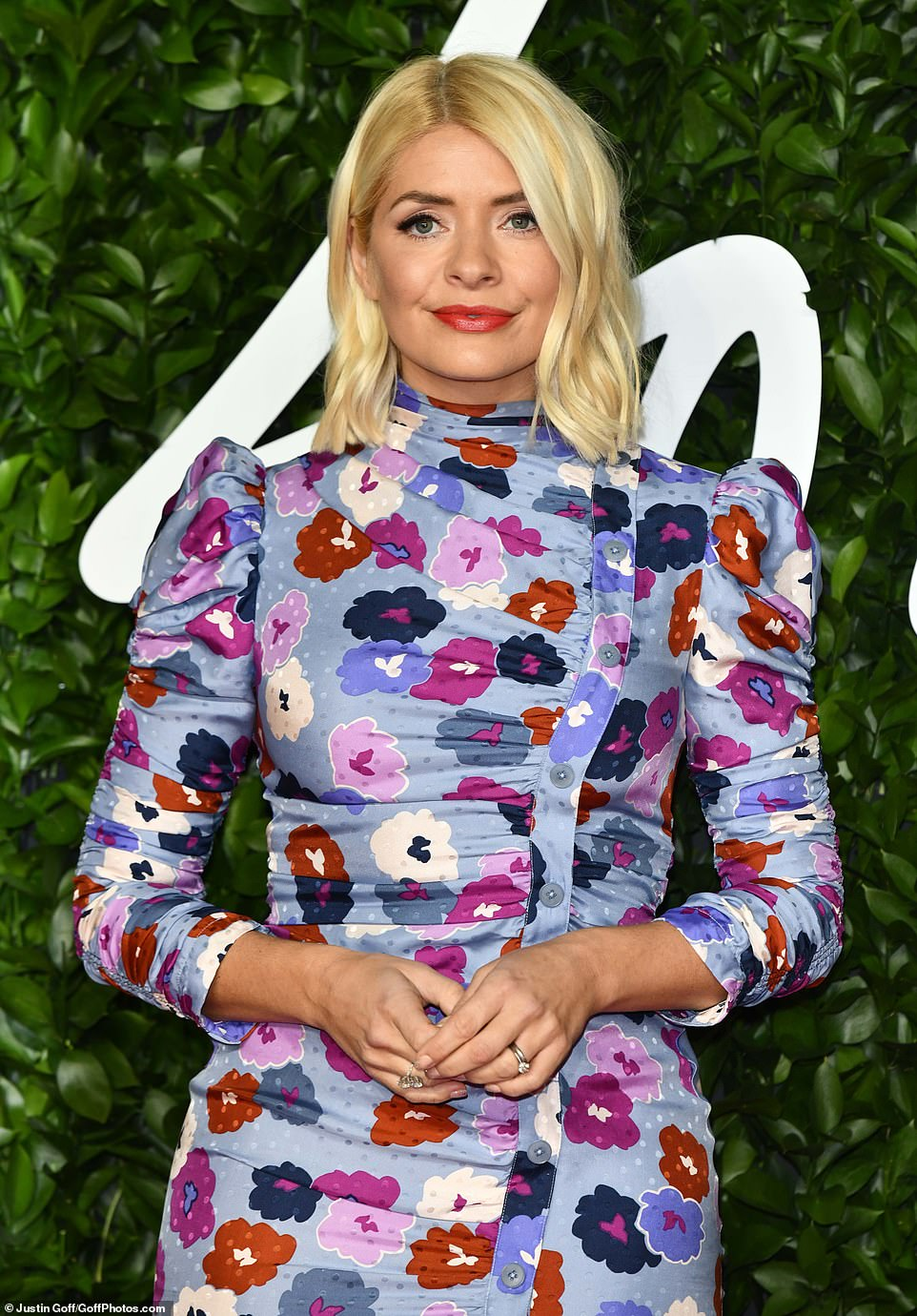 One Hol of a look: The 38-year-old TV darling teamed the look with a bold red lip while her trademark blonde locks were worked into a tousled wave