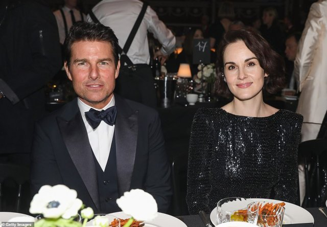 Good company:Inside the bash, she sat next to a dapper Tom Cruise as they enjoyed their luxury VIP dinner