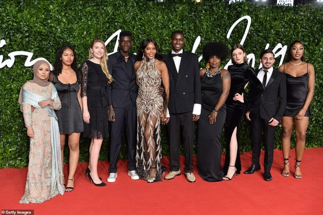 Glam gang: The beauty's dazzling dress stood out as she posed with pals on the red carpet