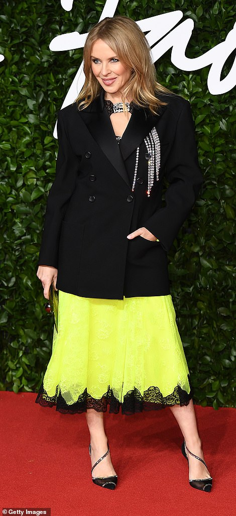 Clashing colours:Kylie Minogue made a style statement in her eye-catching look