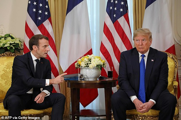President Donald Trump (R) France's President Emmanuel Macron react as they talk during their meeting at Winfield House, London on December 3, 2019. Trump told Macron: 'Would you like some nice ISIS fighters?' as he pushed to have France and other nations accept captured terrorists from their own countries
