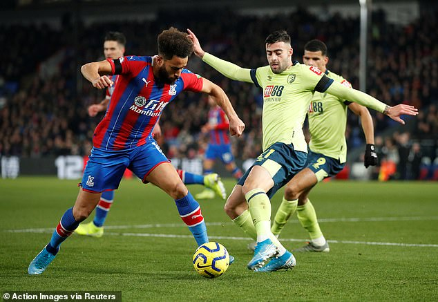 Crystal Palace winger Andros Townsend takes on Bournemouth defender Diego Rico