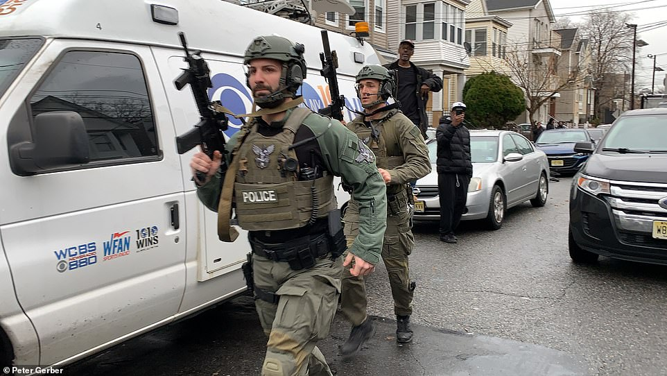 The gunshots continued for the next two hours, according to witnesses, as a heavy police presence from local, state and federal law enforcement agencies flocked to the scene