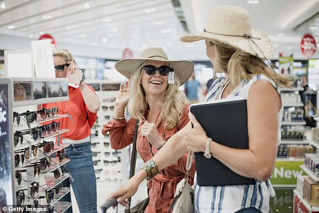 Travellers often kill time by trying on sunglasses, but it's best to stick to window shopping because there's no massive bargains to be had on accessories at duty-free (stock image)