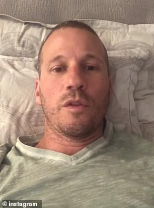 Rosenbaum said his symptoms first began on the weekend before New Year's Eve.  Pictured: Rosenbaum at home recovering