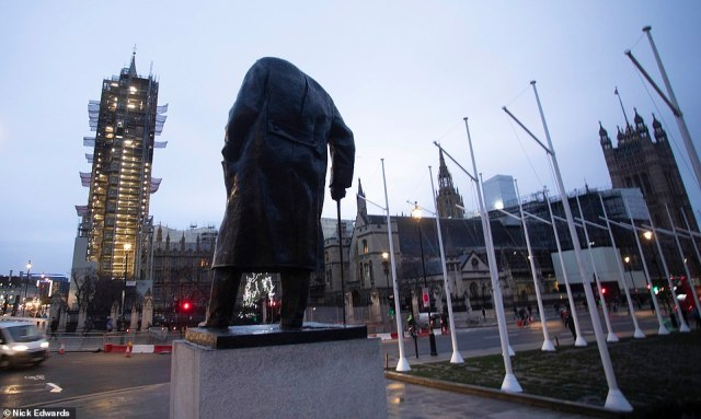 The statue of Sir Winston Churchill - Britain's greatest ever PM - looks on to the Houses of Parliament as a new government will be elected by Britain today