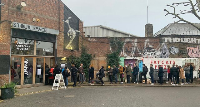 Voters in Bow, east London queue up to vote at a cafe/art gallery being used to serve the electorate today