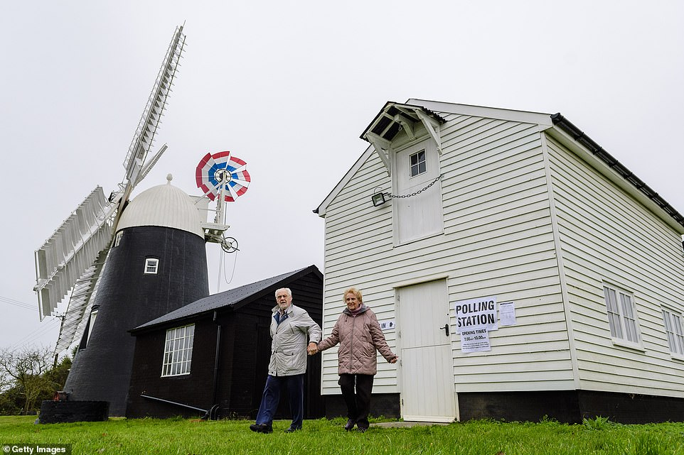 Voters go to the polls in the granary of Grade II listed Thelnetham Windmill on the Norfolk/Suffolk border