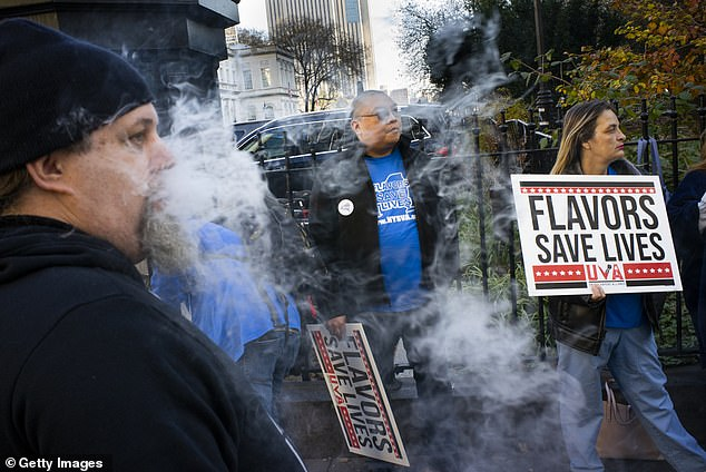 New Yorkers protested the cities proposed ban on flavored e-cigarettes. In a new editorial, some public health experts agree that with the protester's sentiment that 'flavors save lives' and warned the vaping bans may drive people back to smoking (file)