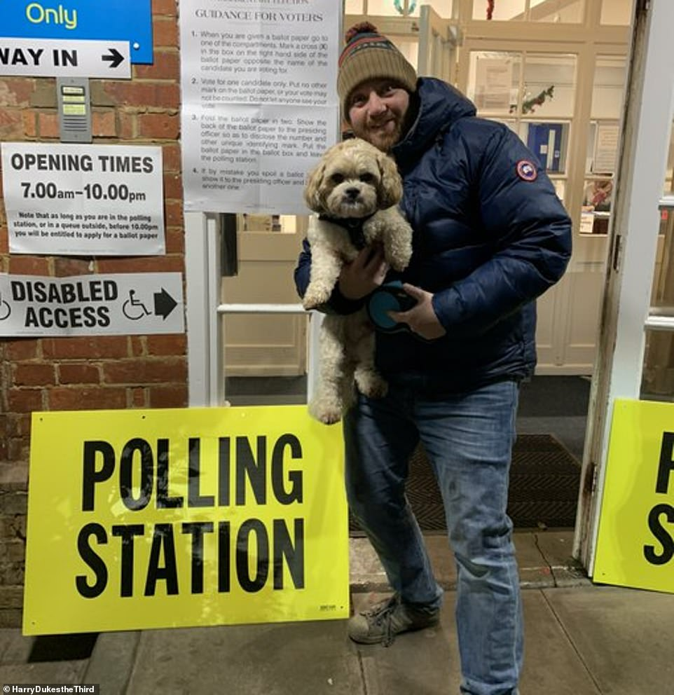 Strike a pose! One man posted this picture of himself and his cute dog outside the polling station and said: 'gone early gone hard'