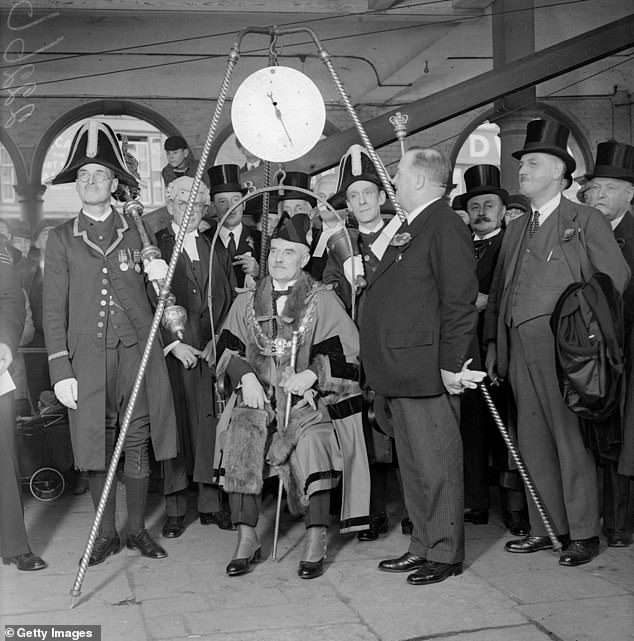 The Mayor of High Wycombe is always weighed upon taking office as well as during the handover ceremony to the next incumbent. Pictured: The new Mayor of High Wycombe being weighed in 1929