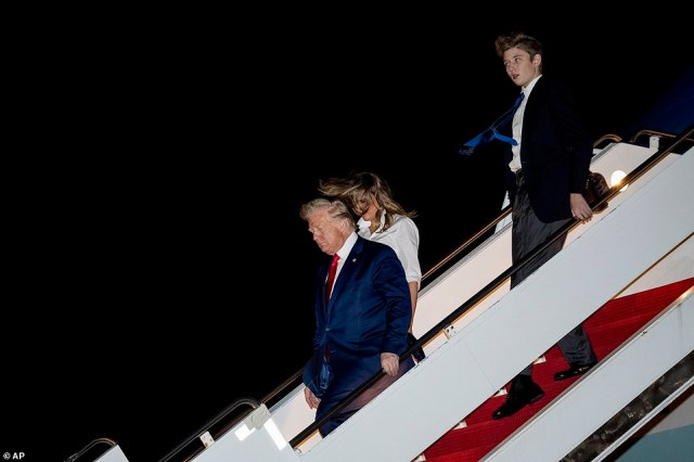 "22522434 7815917 image a 54 1576909999171 The first family landed in their Mar-a-Lago residence in Palm Beach on Friday after departing the White House for the Christmas holiday. Barron Trump was photographed alongside his parents towering over his 6""2 father."
