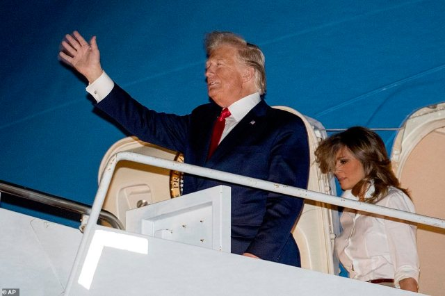 "22522440 7815917 image a 48 1576909978400 The first family landed in their Mar-a-Lago residence in Palm Beach on Friday after departing the White House for the Christmas holiday. Barron Trump was photographed alongside his parents towering over his 6""2 father."