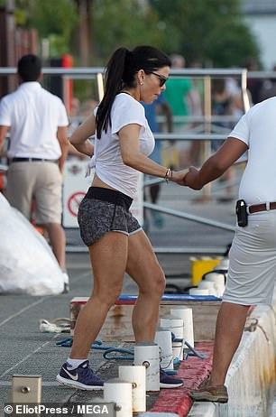 At one point they were seen being helped onto the yacht during an outing on Sunday