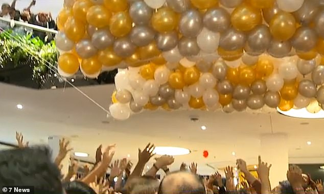 Christmas promotion turned into a disaster as swarms of people rushed to get their hands on the gold and white balloons and caused a stampede