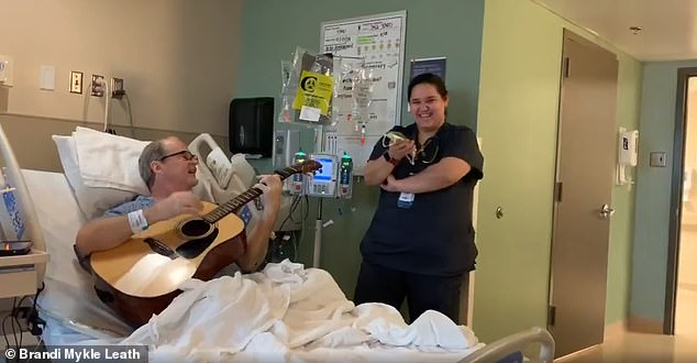 Collazo admitted Pennington into the hospital and, when she learned of his music background, she promised to bring her guitar in for a jam session. Pictured: Pennington and Collazo singing